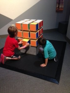 Nathan and a friend solving a wooden Rubik's Cube